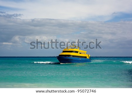 Ferry boat arriving at Playa del Carmen, Mexico. - stock photo