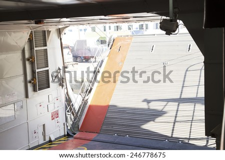 Ferry boat arriving in the harbor - interior view  - stock photo