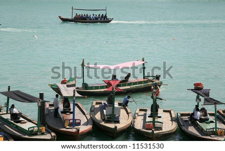 Ferry boat as water taxi on creek - stock photo