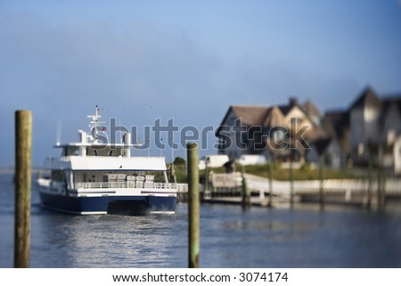 Ferry boat heading into channel on Bald Head Island, North Carolina. - stock photo