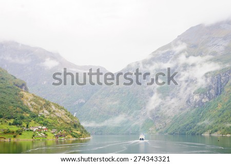 Ferry boat scene in the Geiranger fjord, Norway - stock photo