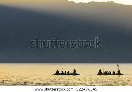 Ferry Boatman in the lake with Fog at Sunrise silhouette