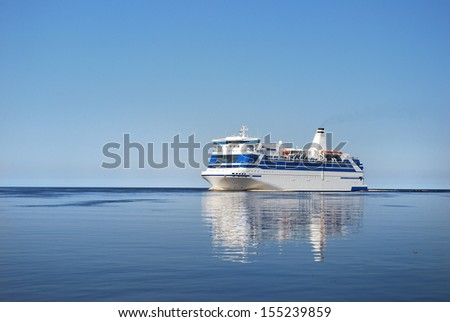 Ferry entering port of Riga - stock photo