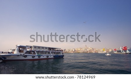 Ferry in Istanbul - Cityscape with Galata Tower and Galata Bridge in the Background
