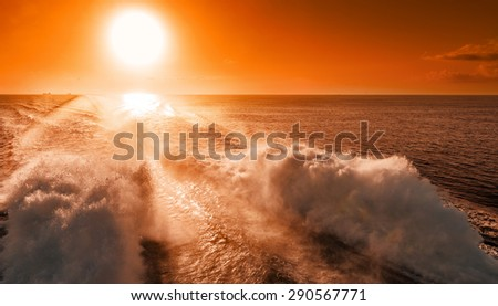 Ferry liner powerful engines lift high spray at the back of the ship - stock photo