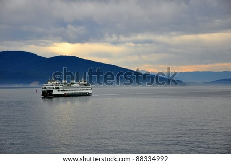 Ferry on the ocean in the late afternoon - stock photo
