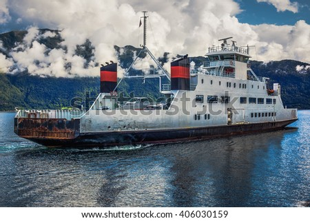 Ferry over fjord in Norway contrast colors effect - stock photo