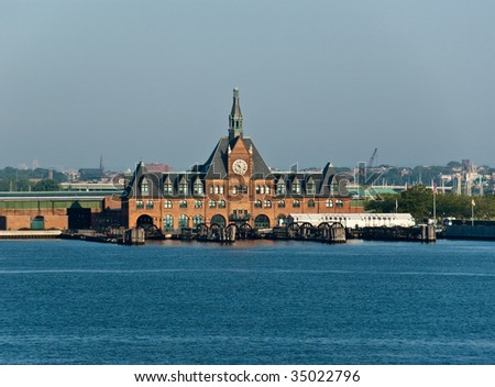 Ferry pier on Liberty Island, NY Harbour - stock photo