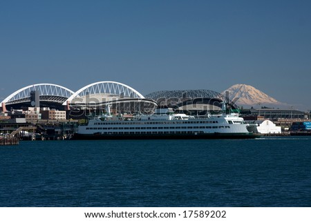 Ferry pulling into the Seattle waterfront - stock photo