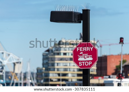 Ferry sign on post in Victoria, British Columbia, Canada - stock photo