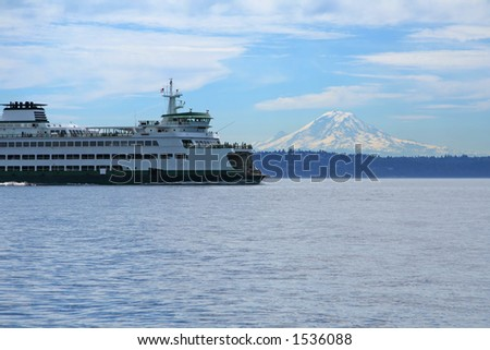 Ferry with snowy mountain peak on the background