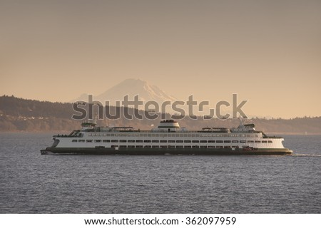 Ferryboat and Mt. Rainier. A ferry from Edmonds Washington makes the crossing to Kingston on the Olympic Peninsula in the Puget Sound area of western Washington state. Mt. Rainier is in the background