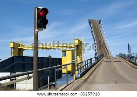 Ferryboat bridge or platform with red traffic light - stock photo