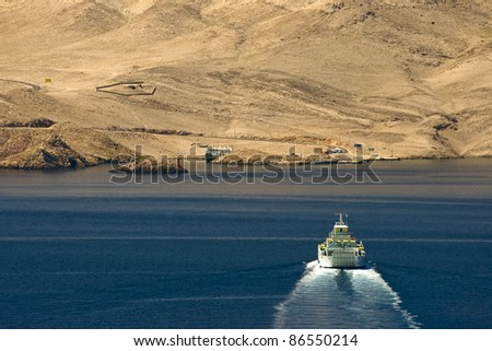 Ferryboat driving from the Prizna port towards the island - stock photo