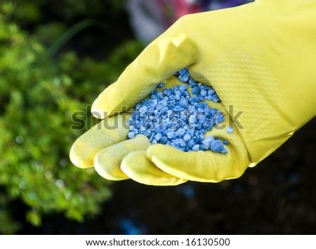 Fertilizer in hands - stock photo