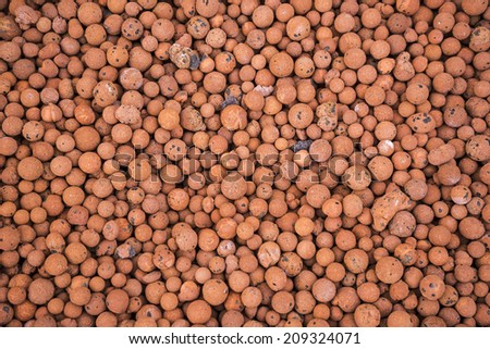 Fertilizing balls. Compost background - stock photo