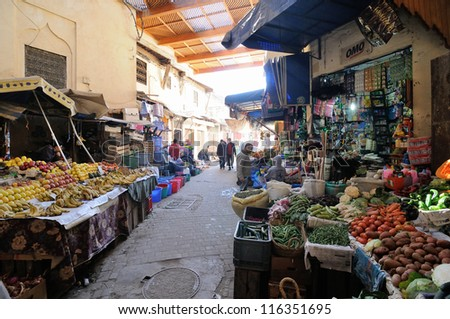 FES - MARCH 09: Arabic people at covered market  (souk) in a city Fes in Morocco. Fes is a historic city listed in UNESCO. March 09, 2012 Fes, Morocco. - stock photo