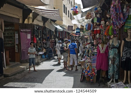 FES, MOROCCO - JULY 27: People on a street market on July 27, 2010 in Fes, Morocco. Fes center is listed in UNESCO and it is the largest preserved medieval city in the world. Also it's one big market.