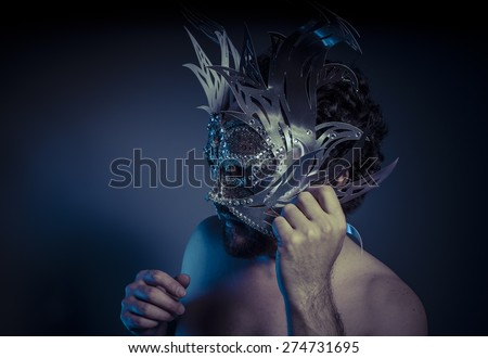 Festival, Mystery and Renaissance, adult man with mask silver and precious stones - stock photo