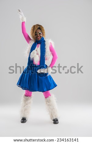 Festive african woman wearing funny costume posing on gray background - stock photo