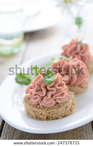 Festive appetizer: sandwich with turkey pate - stock photo