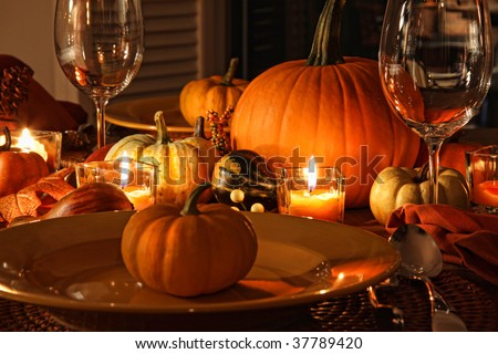 Festive autumn place settings with pumpkins and candles - stock photo