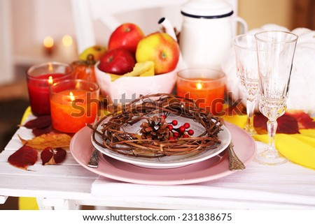 Festive autumn serving table in room - stock photo