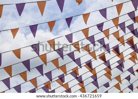 Festive background with colored flags , - stock photo