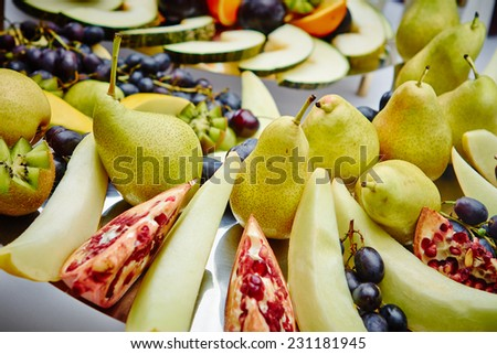 Festive banquet table with delicious fruit in restaurant.