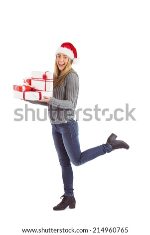 Festive blonde holding pile of gifts on white background