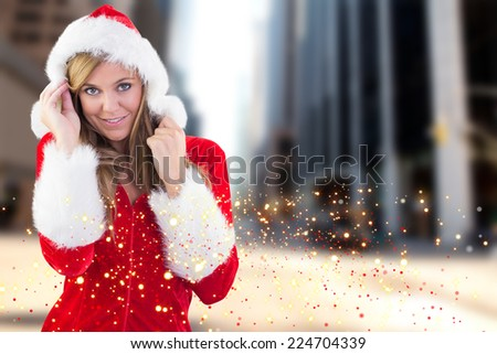 Festive blonde smiling at camera against new york street - stock photo