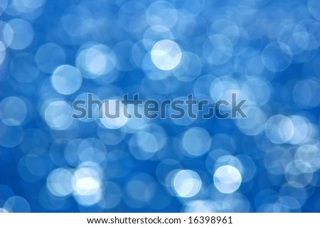Festive blue bokeh perfect for holiday backgrounds.