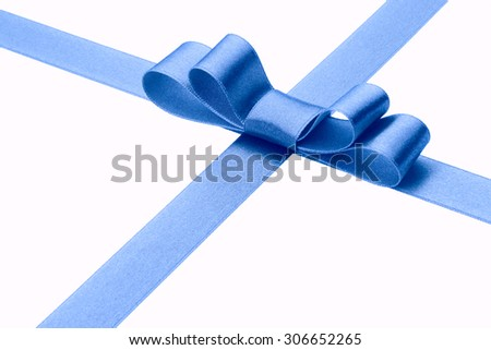 Festive blue gift ribbon and bow  - stock photo