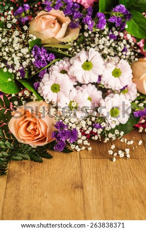 Festive bouquet of different flowers on table. - stock photo