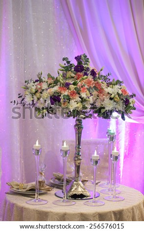Festive bouquet of flowers on wedding table