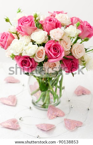 festive bouquet of pink and white roses in vase - stock photo