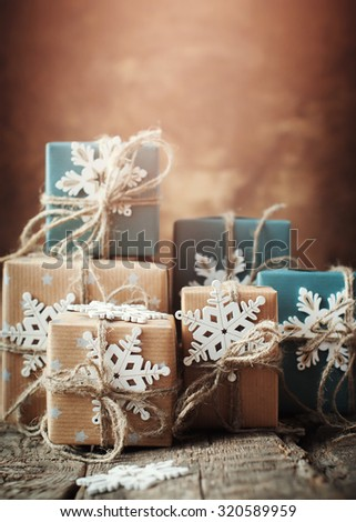Festive Boxes Decorated in Blue Paper with Snowflakes, Linen Cord on Wooden Table. Toned with Light Shine Effect - stock photo