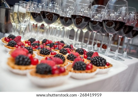 Festive buffet at the event with desert, champagne and wine. Soft focus  - stock photo