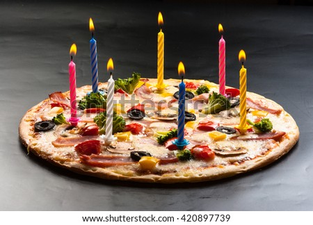 Festive candles pizza with mushrooms, cauliflower, olives, cheese and sweet pepper - stock photo