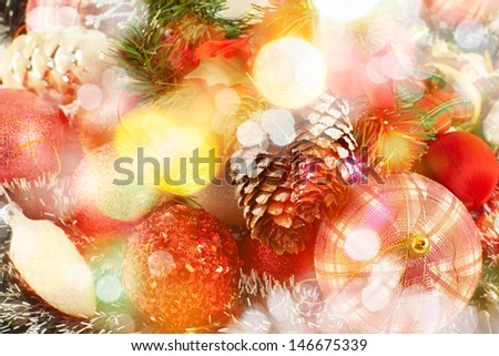 Festive Christmas background of xmas balls and decorations under defocused bokeh effect on the foreground