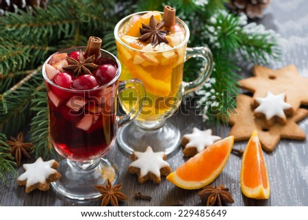 festive Christmas beverages, biscuits and spices on a wooden table, close-up - stock photo