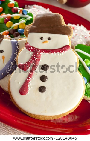 Festive Christmas Cookie in the shape of a snowman - stock photo