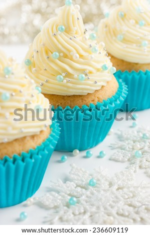 Festive Christmas cupcakes with frosting and sugar decoration, selective focus - stock photo