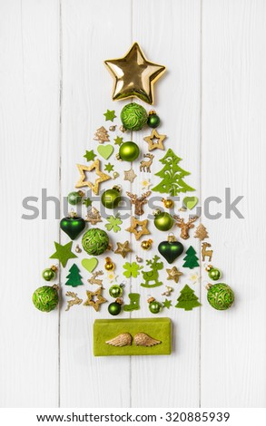 Festive christmas decoration in light green, white and golden color. Collection of xmas miniatures. - stock photo