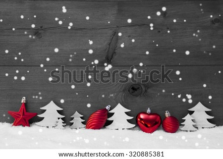 Festive Christmas Decoration On White Snow. Christmas Ball, Christmas Tree, Snowflakes. Rustic, Vintage Wooden Background. Copy Space For Advertisement. Black And White Image With Red Color Hotspot - stock photo
