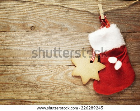 Festive Christmas decoration over wooden board background - stock photo