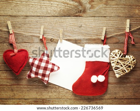 Festive Christmas decoration over wooden board background with blank paper card - stock photo