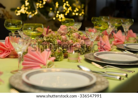 Festive Christmas table in soft pastel colors pink and green - stock photo