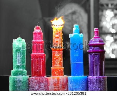 Festive colorful candles in the center of Lviv as a symbol of the city - stock photo