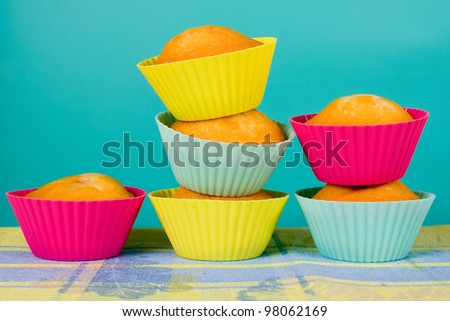 Festive cupcakes on gradient background